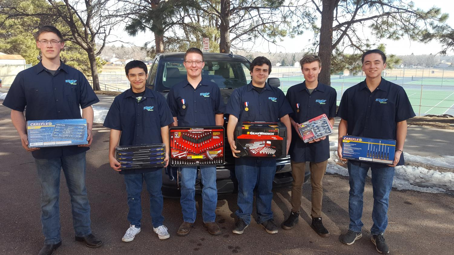 Pictured here are Doherty students with Tool prizes from Pikes Peak Napa Auto Care.  . They are standing in front of a 2017 Silverado that we won at SKILLS USA nationals in 2018.