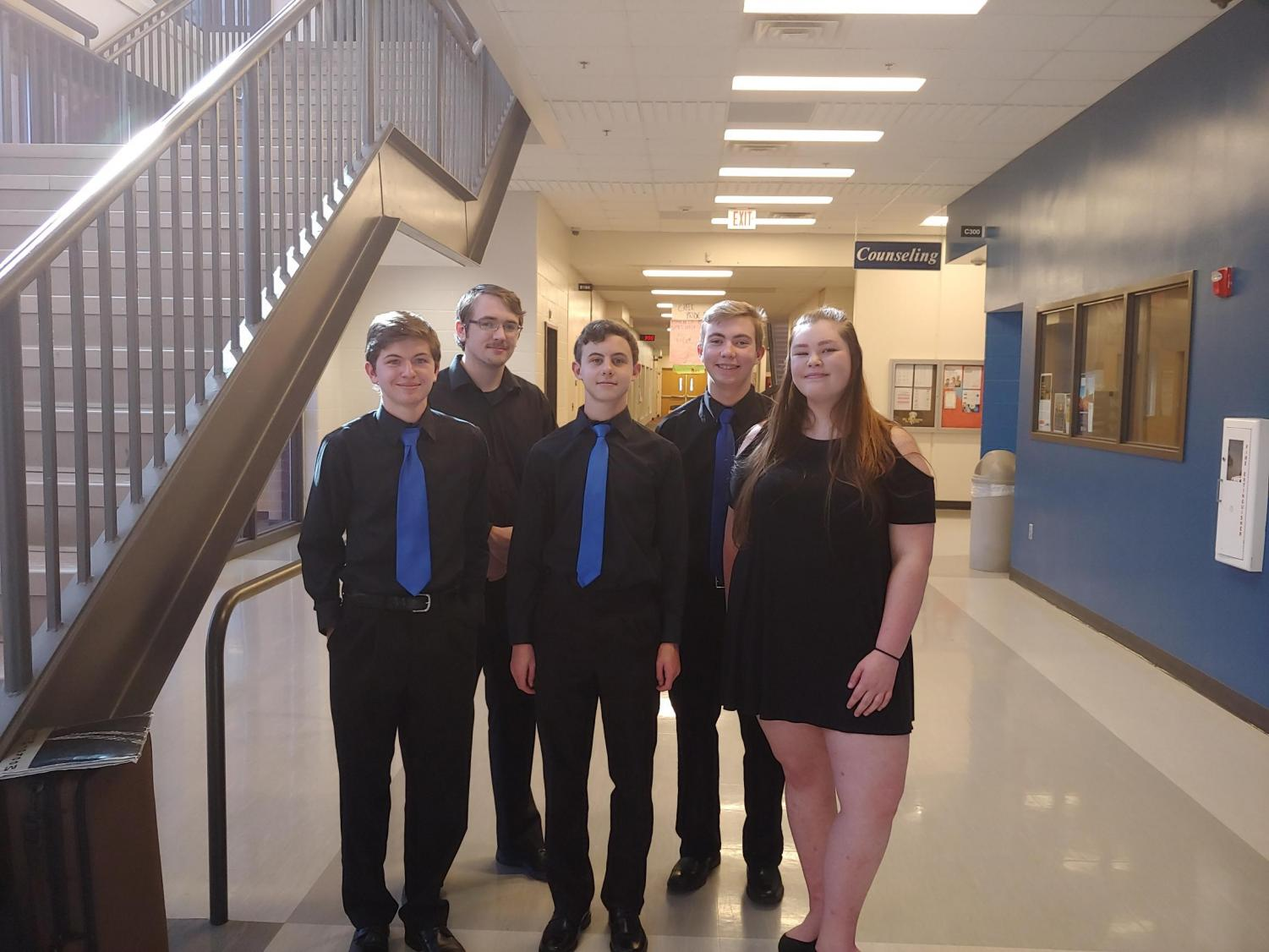 Doherty orchestra students pose at their competition on April 5th.