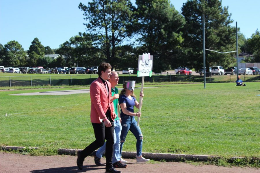 Thomas Hollon and Mr. Ahnfeldt walking out at the Homecoming assembly.