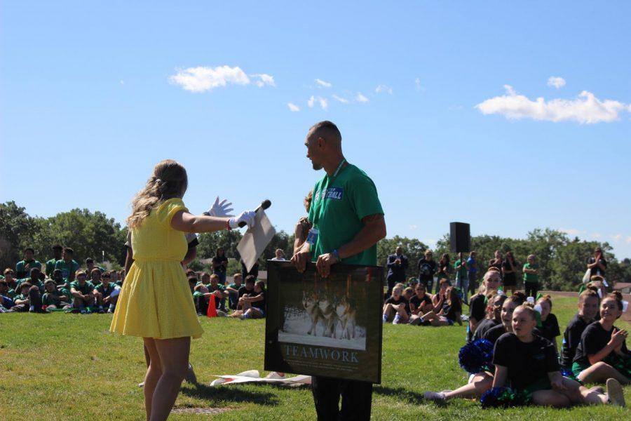 Vice President Ashlynn presents Mr. Kalawe with a framed poster