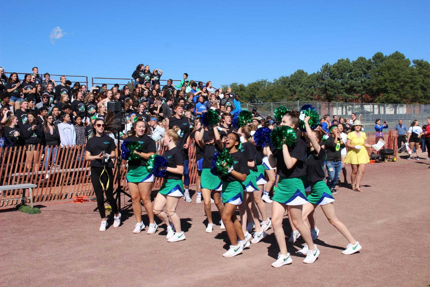Poms celebrate during the 2019 pep rally held outside during September.