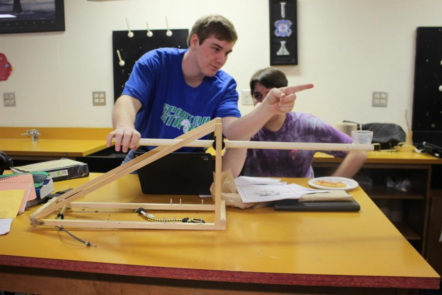 Jack Bopp and his partner modifying their project catapult.
