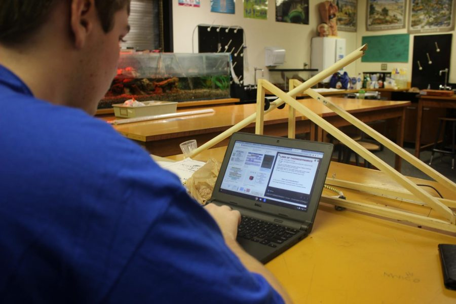 Jack Bopp working on his catapult project.