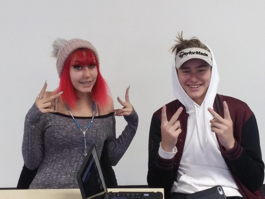 Students Janessa Taylor and Joe Dittburner wear their hats freely and openly now that the policy has changed.