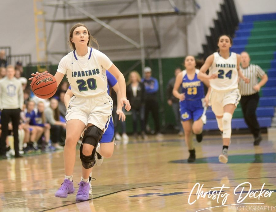 Taylor Corsi drives to the basket during a game against Rampart. Photo credits: Christy Decker