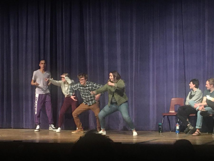 Cole Russel, Ashlynn Von Ackerman, Aaron Southard and Brianna Curly, perform an improv game.